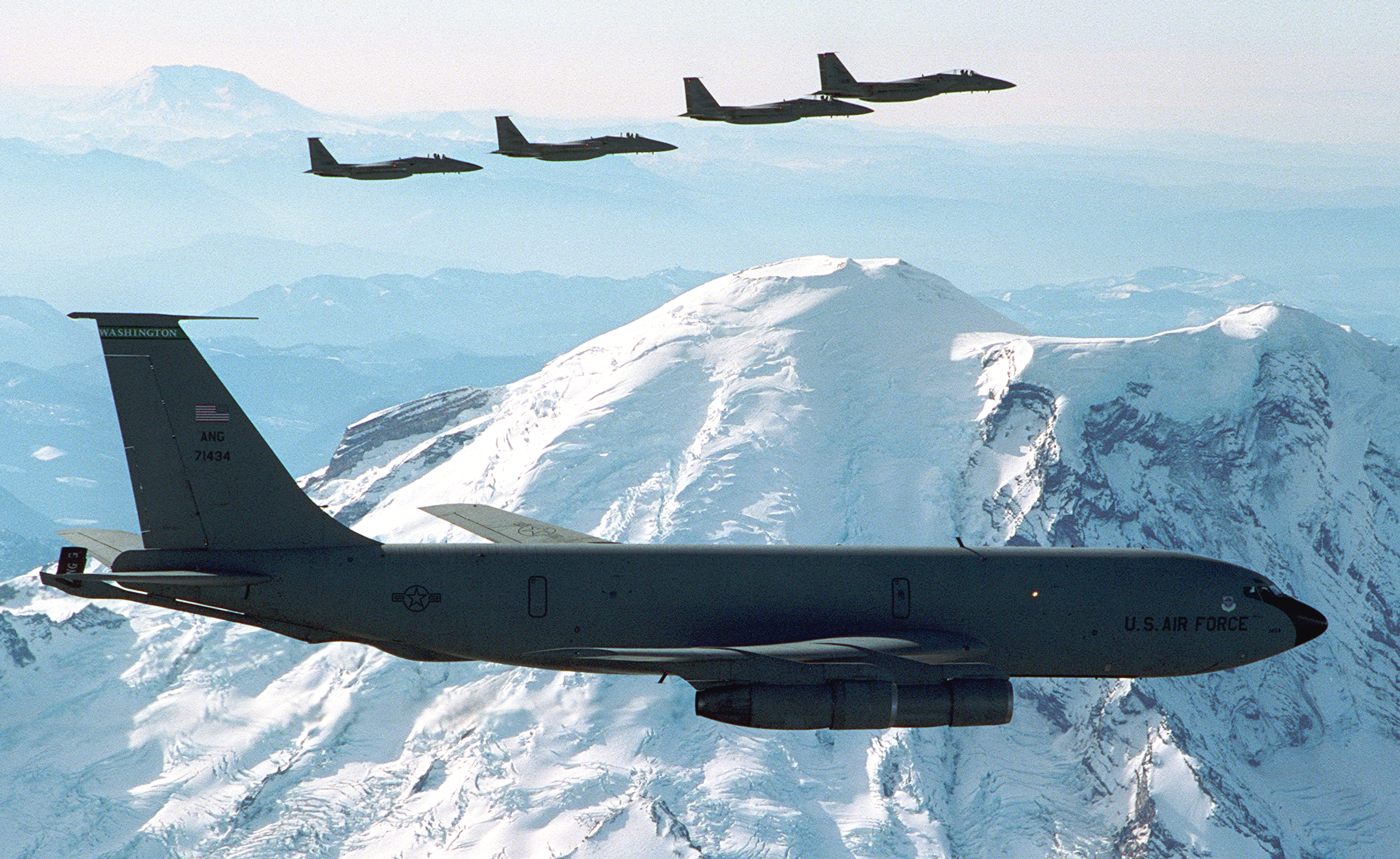 KC-135 from the Washington Air National Guard, 141st ARW was photographed by Mt. Rainier on 22 Nov 00. F-15s from the 142nd Fighter Wing, Oregon Air National Guard are in the background.